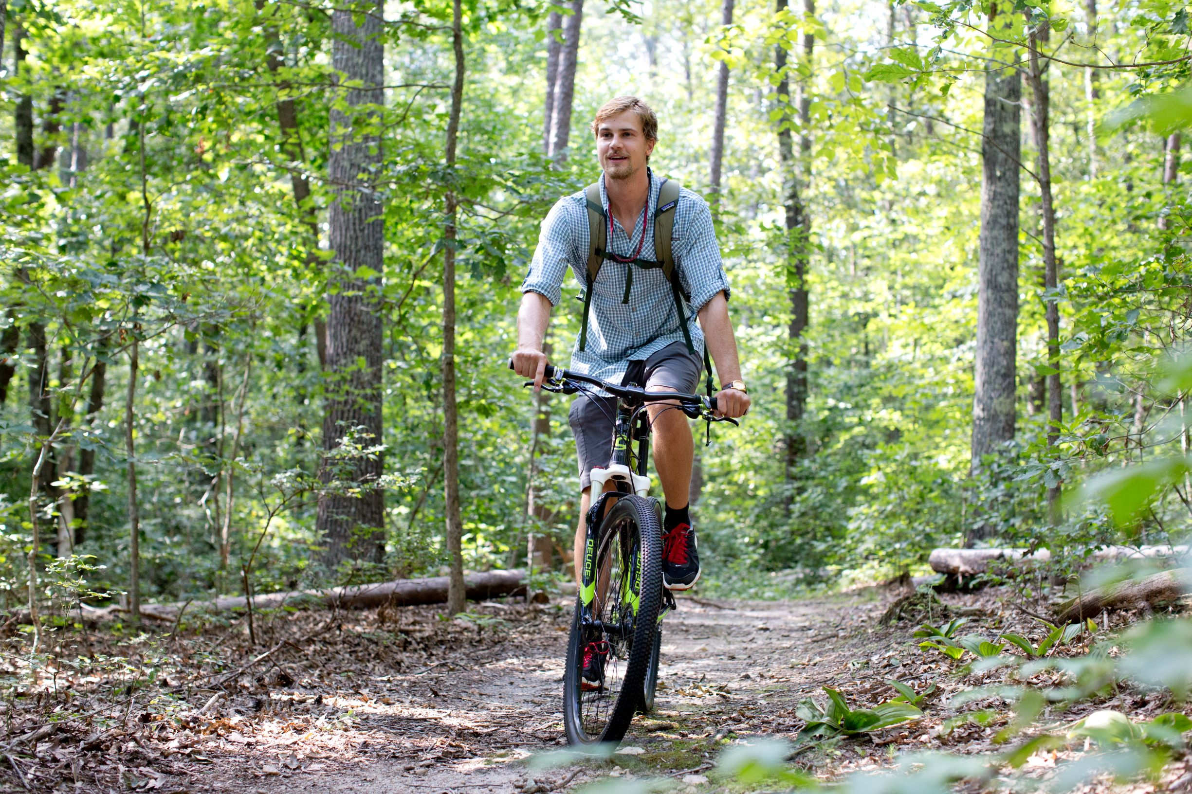 This is a man mountain biking on the Wilson Trail in Hampden-Sydney, Virginia